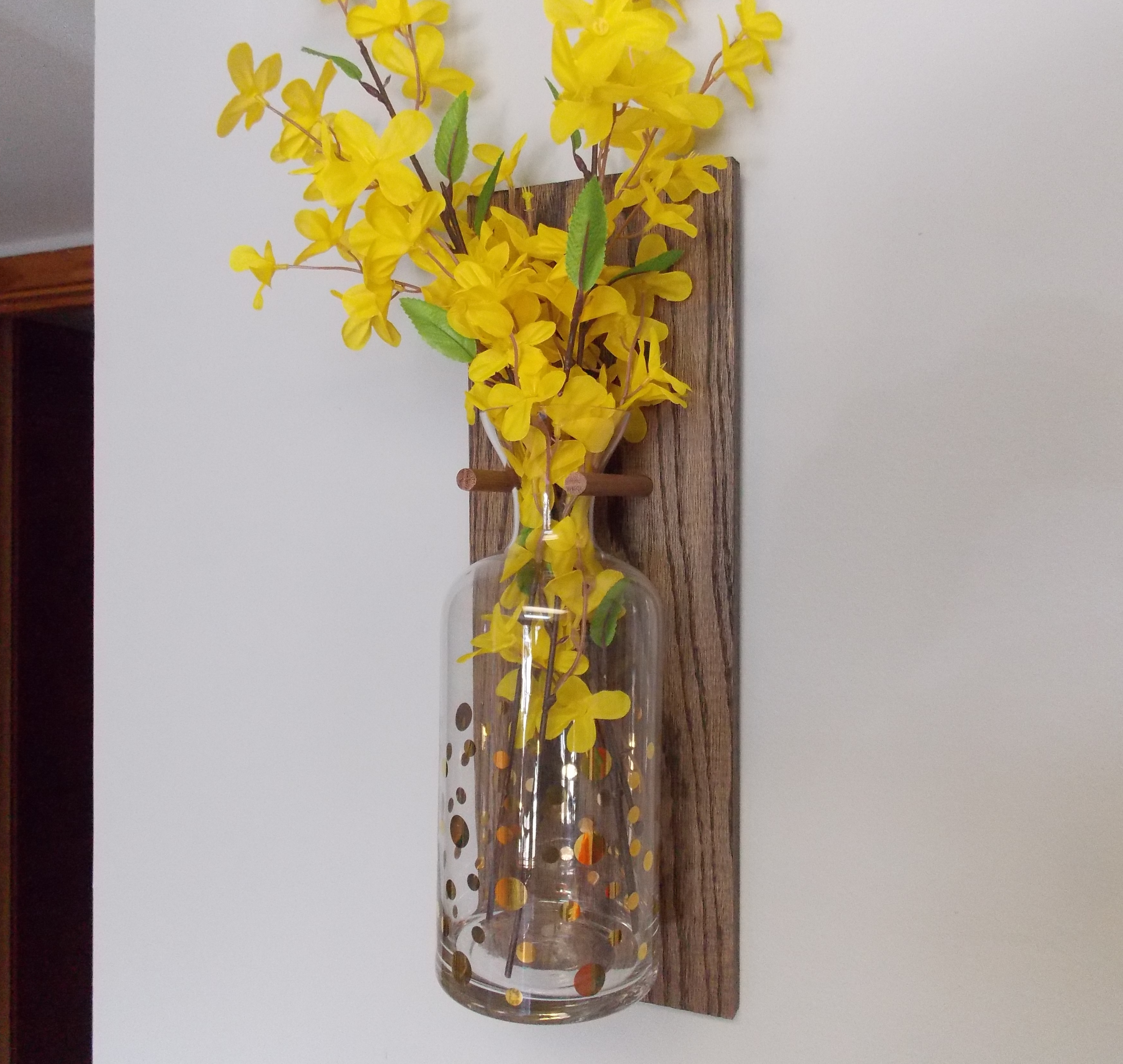 Add color to any room with these hanging vases minwax blog as for my two holes and the dowels they were precisely placed to allow me to slip the neck of this tall glass vase between them reviewsmspy