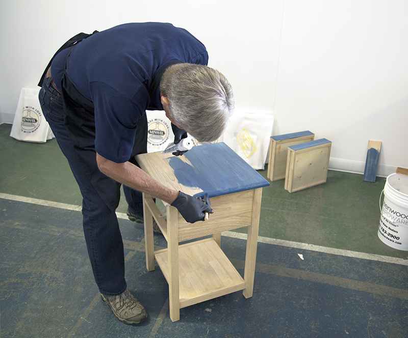 Bruce Johnson applying blue Minwax stain