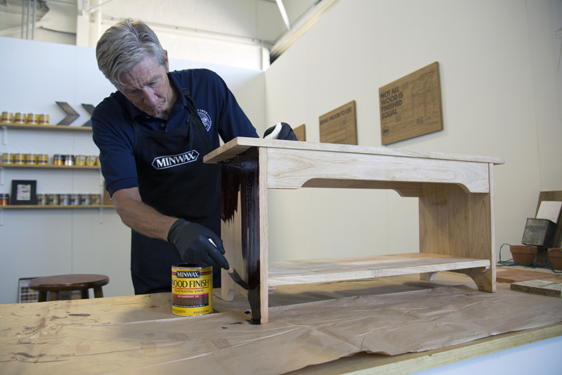 Bruce Johnson staining the bench base