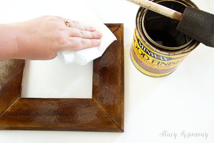 wiping excess stain off frame