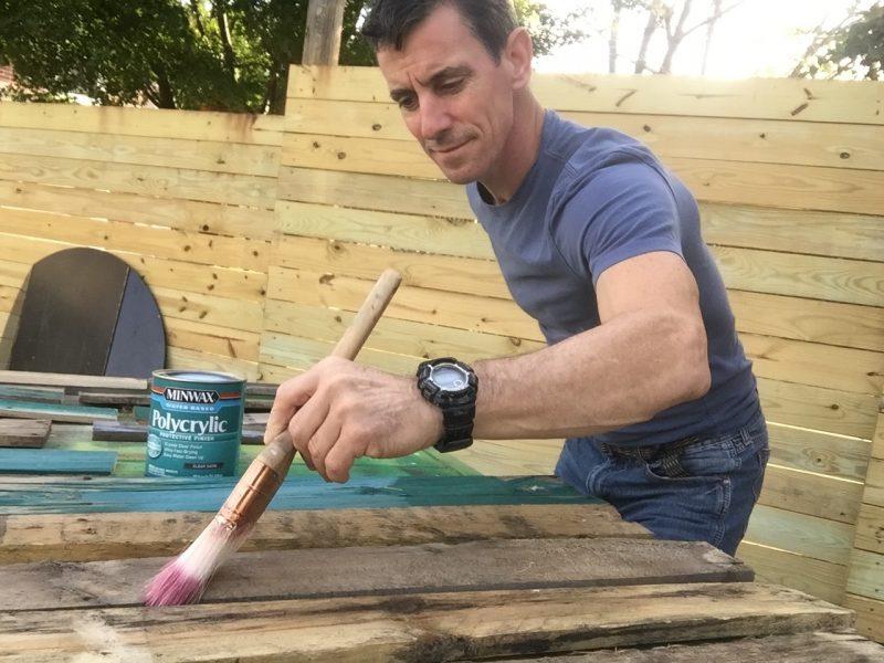 Mark applying Minwax Polycrylic