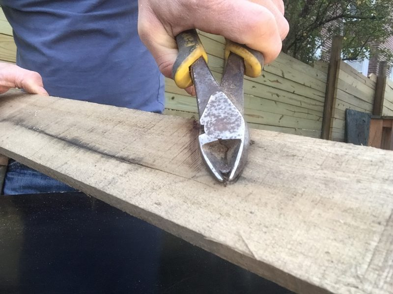 Removing a nail with pliers