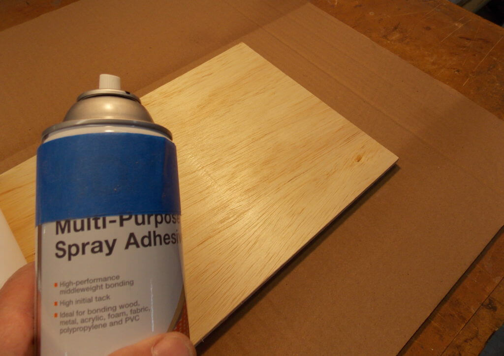 Use aerosol adhesive to secure map print to birch plywood backing
