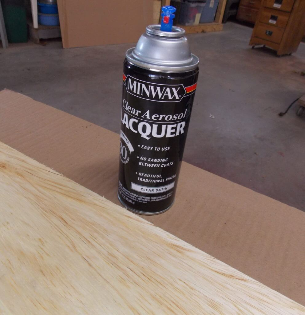 Piece of cut birch plywood sealed with Minwax Clear Aerosol Lacquer