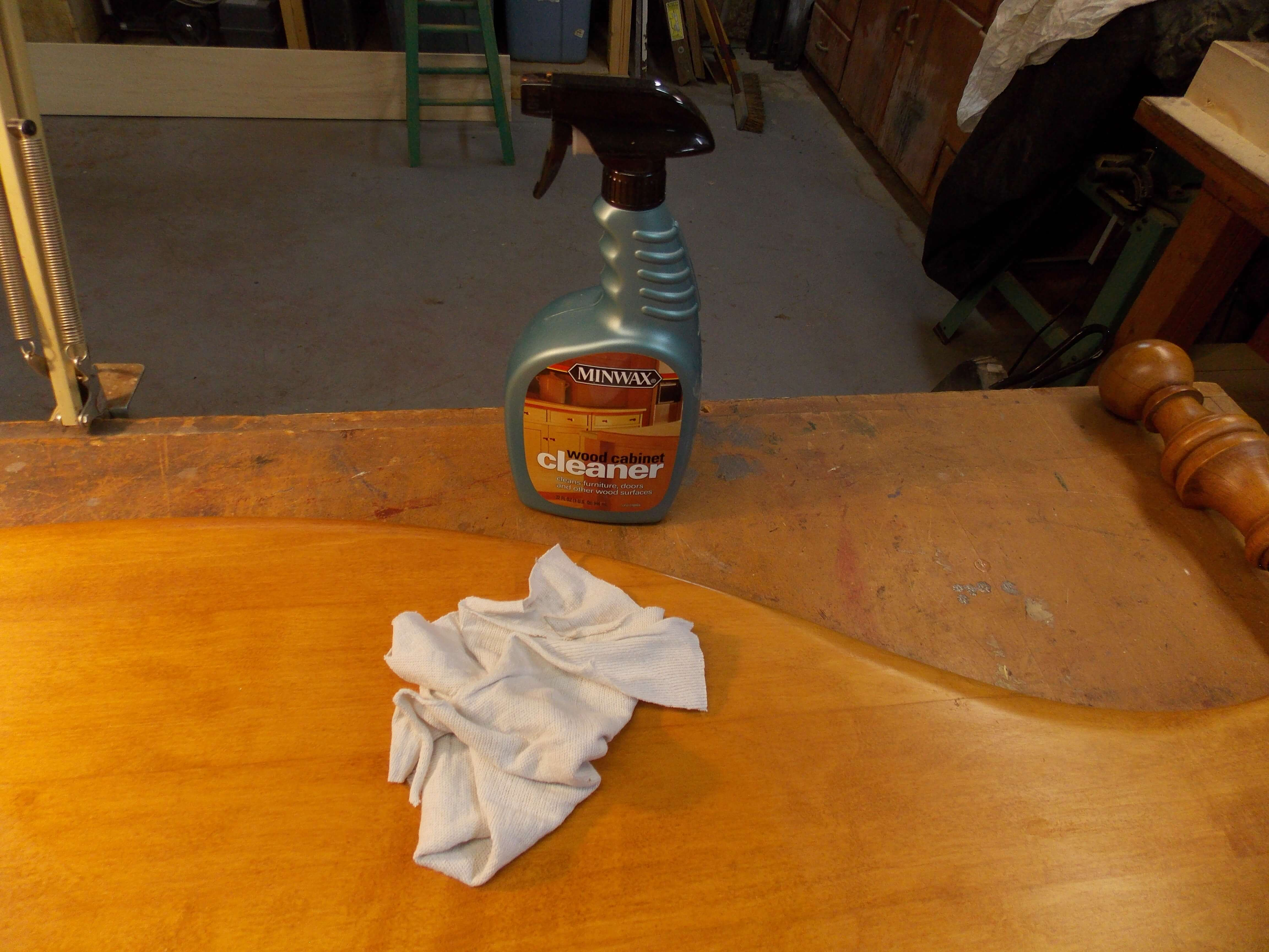 Using Minwax Wood Cabinet Cleaner removes old dirt and grime