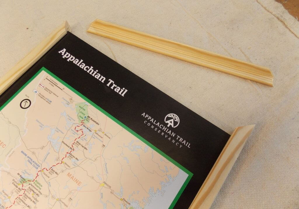 Cut pieces of pine molding to make the map frame