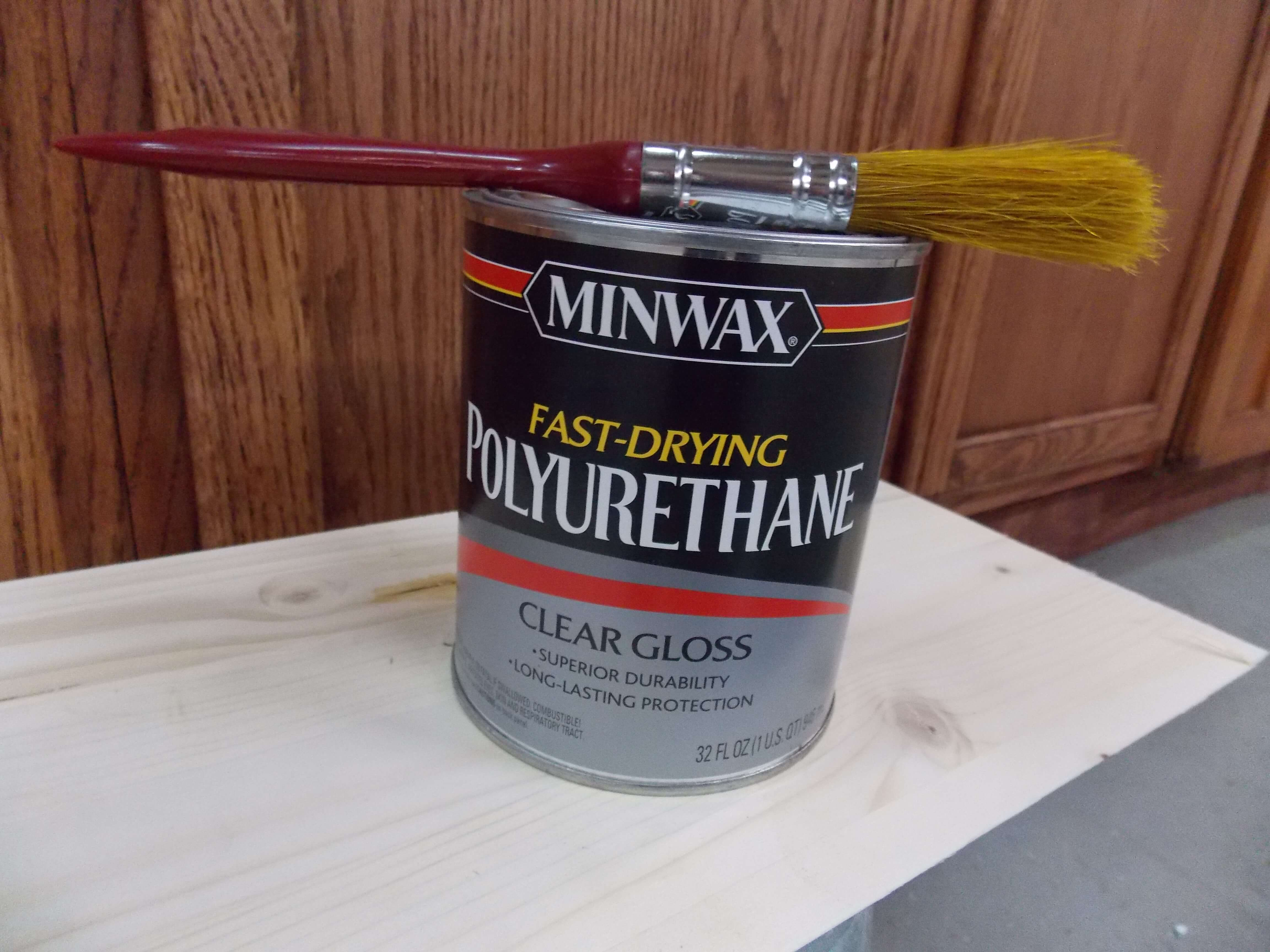Apply a coat of fast-drying polyurethane to seal in cabinet stain