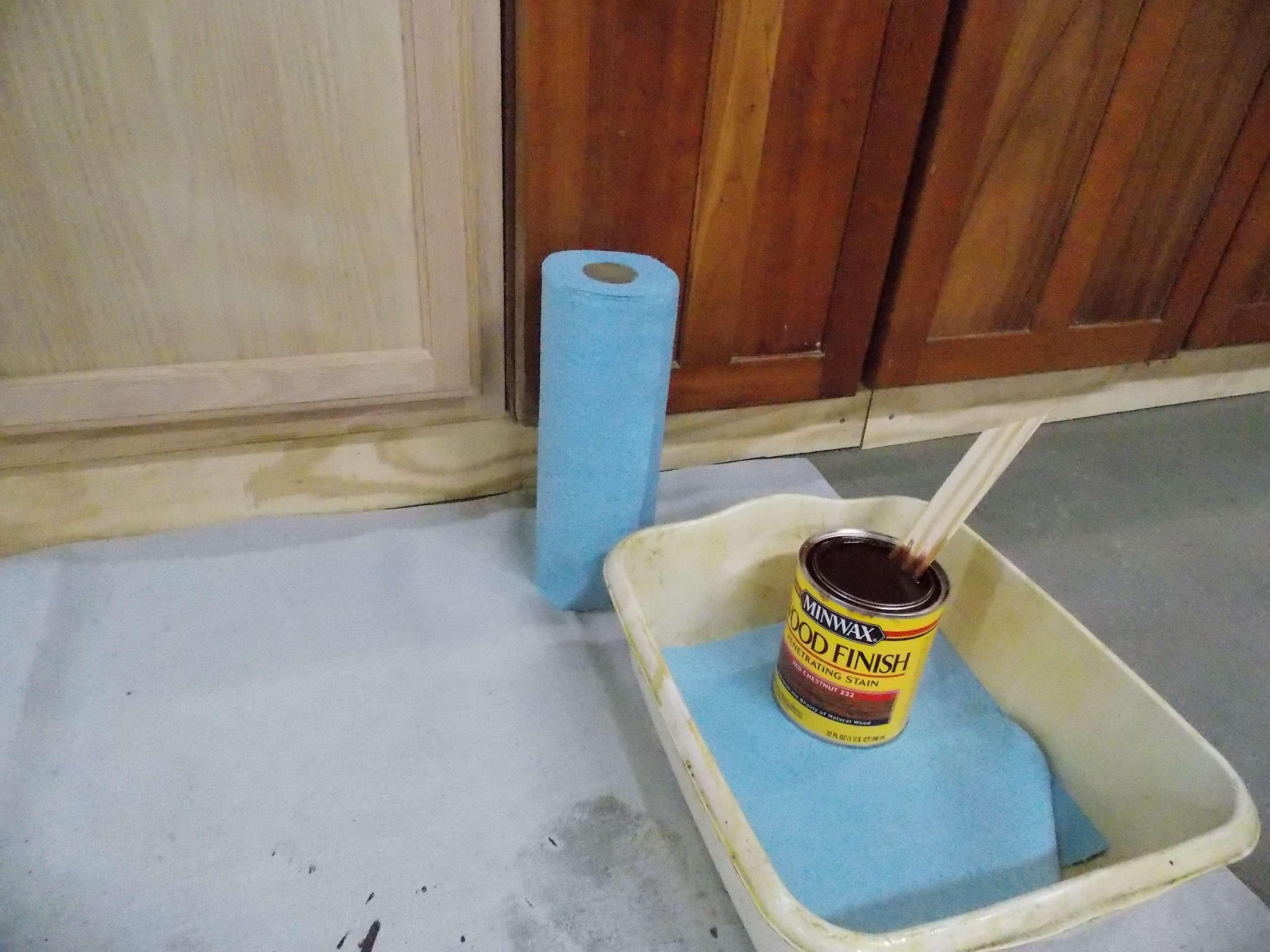 Preparing to apply Minwax wood finish to oak cabinets