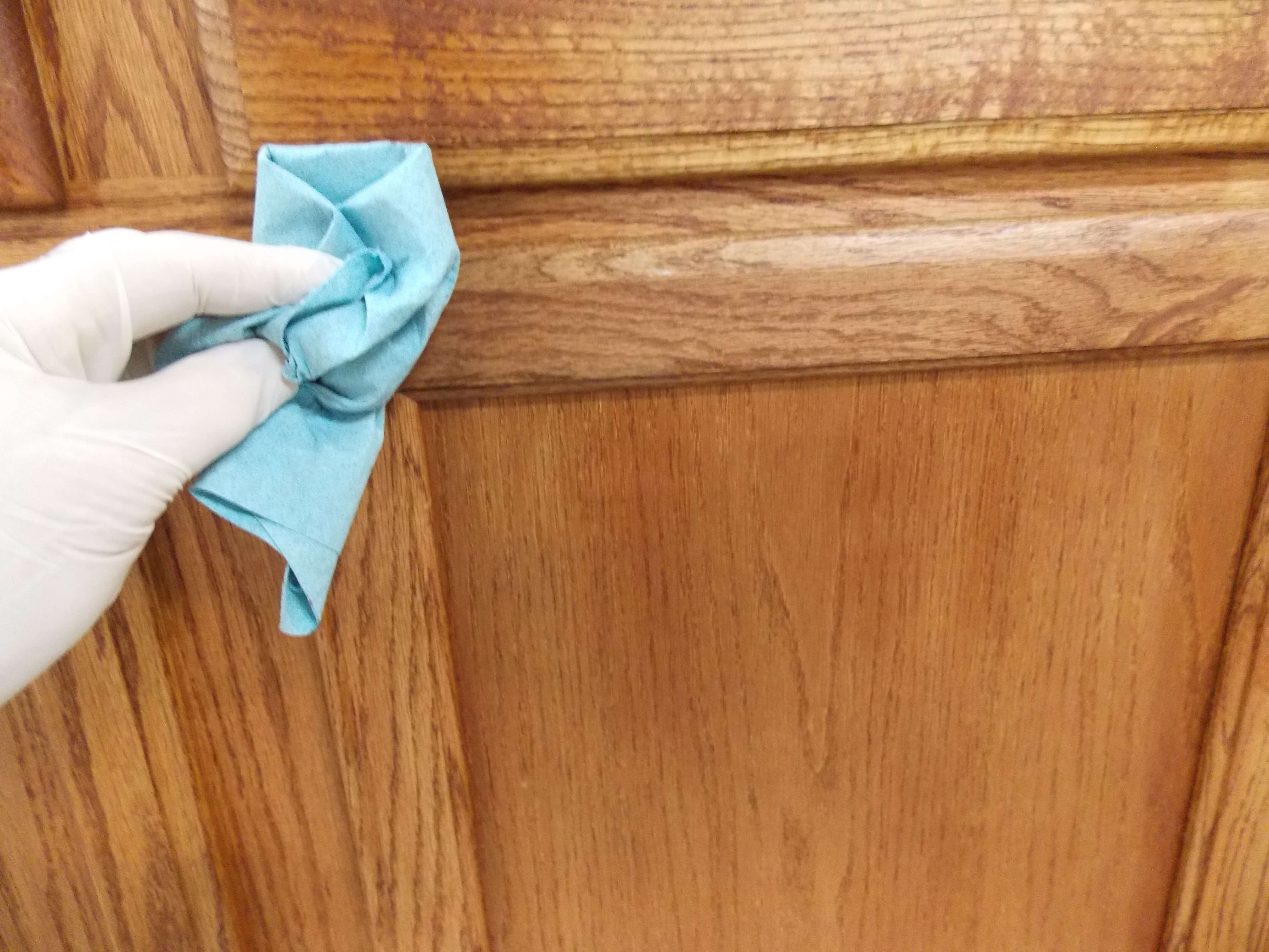 Removing excess stain will reveal the finished look of the cabinets