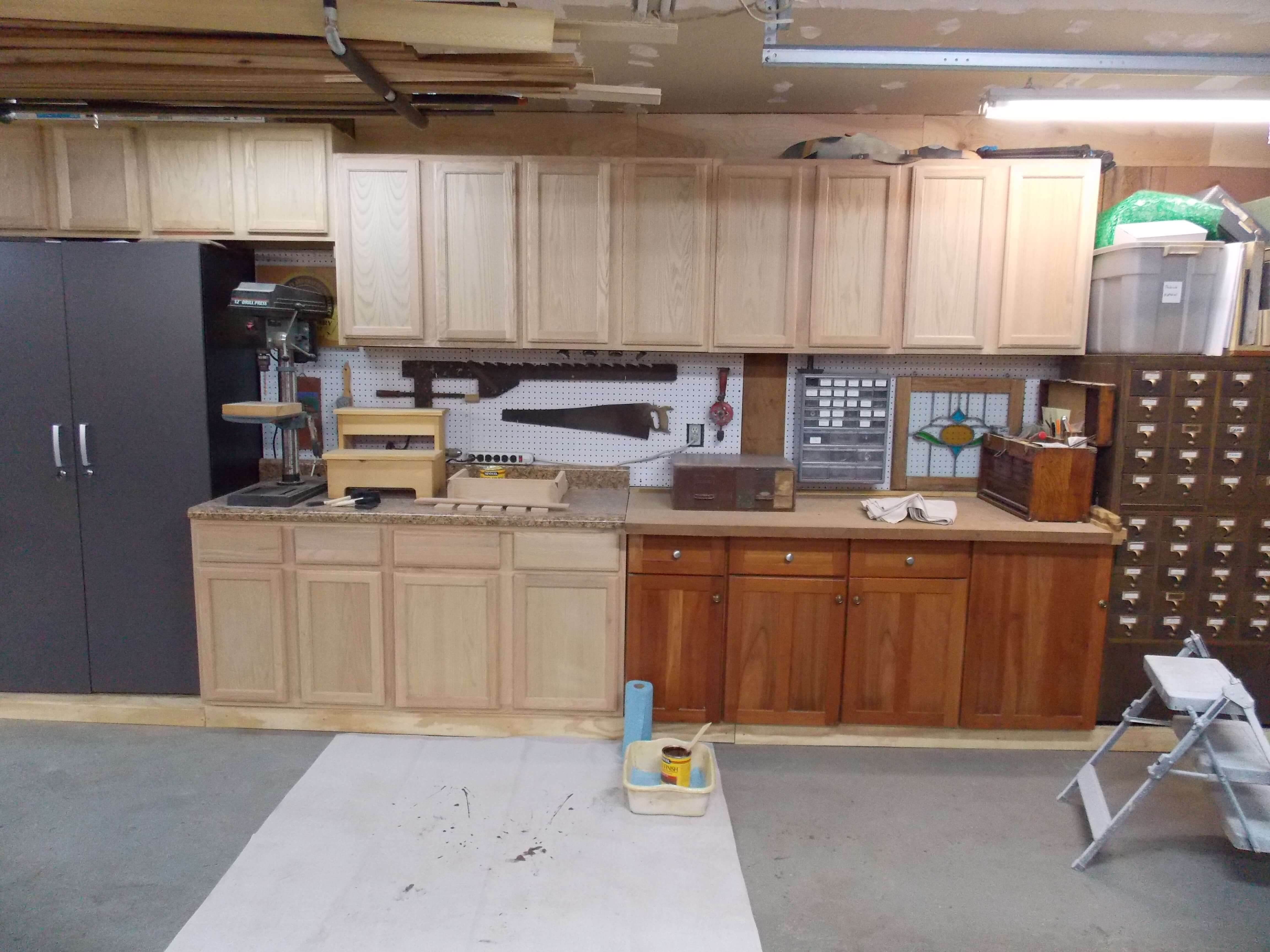 Unfinished oak cabinets before staining